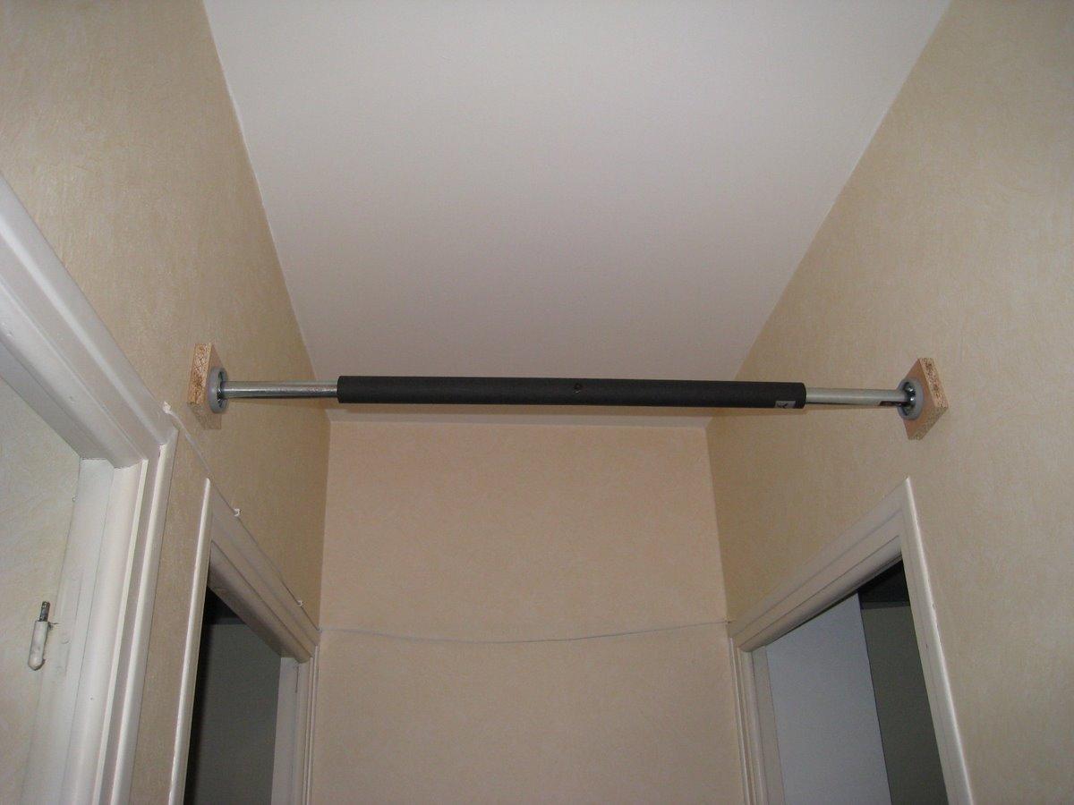 barre de traction entre deux murs